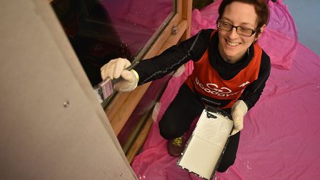 Members of The GoodGym Norwich helping to decorate The Hamlet head office.Picture: ANTONY KELLY