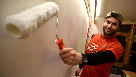 Members of The GoodGym Norwich helping to decorate The Hamlet head office. GoodGym trainer Steve Hit