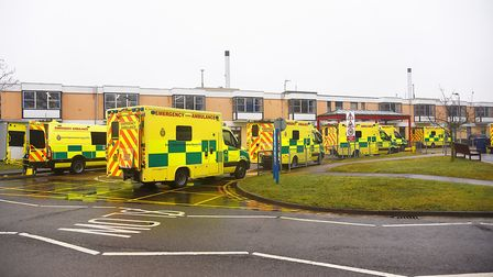 A line of ambulances waiting outside the A&E Department at the Queen Elizabeth Hospital in King's Ly