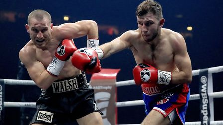 Ryan Walsh takes evasive action in his fight against Isaac Lowe. Picture: PA