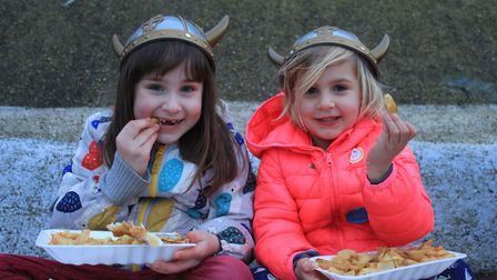 Young 'Vikings' tucking into fish and chips on the prom. Photo: KAREN BETHELL