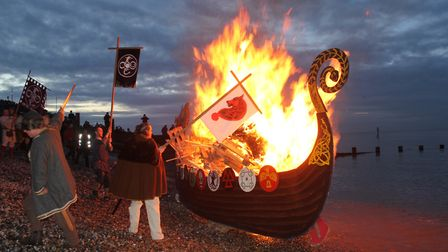 The Viking longboat goes up in flames. Photo: KAREN BETHELL