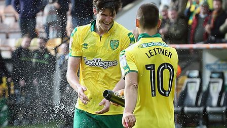 Moritz Leitner playfully soaks Timm Klose as he laps up the congratulations of the Norwich City fans