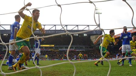 Timm Klose runs off to celebrate scoring Norwich City's derby equaliser in the fifth minute of added