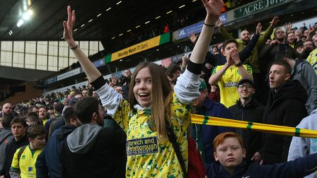 The Norwich fans in the Barclay end celebrate their sides point at the end of the Sky Bet Championsh