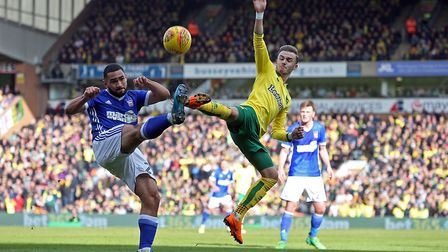 James Maddison tussles for the ball in the first half at Carrow Road. Picture: Paul Chesterton/Focus