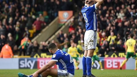 Ipswich Town's Cameron Carter-Vickers, left, and Cole Skuse look dejected after conceding a late equ