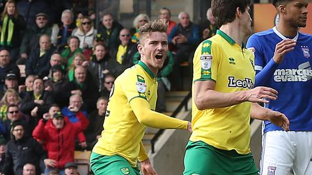 Dennis Srbeny turns to celebrate with Timm Klose after the defender's late equaliser against Ipswich