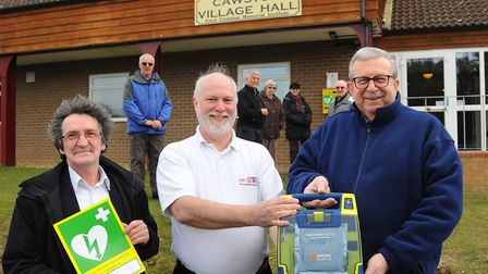 Martin Fagan, from Community Heartbeat (centre), said defibrillators needed to be checked regularly.