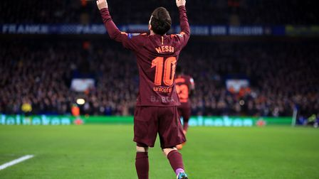 Barcelona's Lionel Messi celebrates scoring his side's first goal of the game during the UEFA Champi