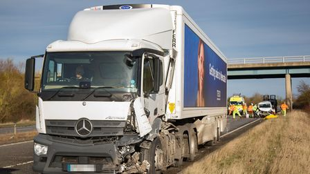 Police at the scene of the collision between a lorry and a van on the A47 at Tilnet All Saints. Pict