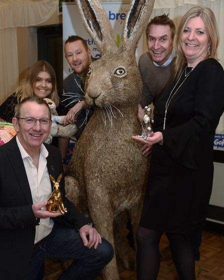 The GoGoHares team with the Norse Hare, and the new merchandise. From left, Michael Rooney, Ellie Ed