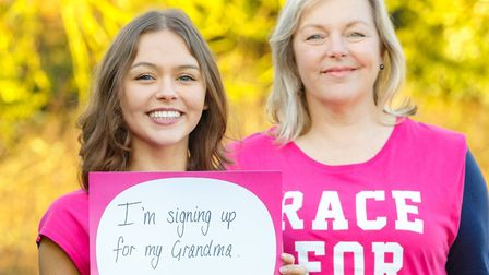 Sally Millsopp, 53, and her daughter Eleanor, 17 holding their Race for Life back signs. Photo: Mar