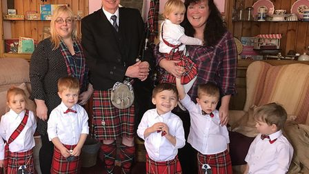 Children from Sara and Jenny's Childminding with bagpiper Ian at Ealing House. Picture: Sara Brannan