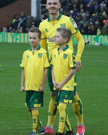 James Maddison with the mascots for the match against Middlesbrough, including Ethan Thomas, left. P