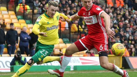 James Maddison and Ben Gibson tussle for possession at Carrow Road. Picture: Paul Chesterton/Focus I
