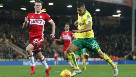 Norwich past and present with Onel Hernandez powering away from Jonny Howson. Picture: Paul Chestert