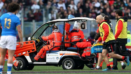Ben Youngs leaves the pitch on a stretcher during England's win over Italy. Picture: Steven Paston/P