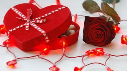 Valentine's Day chocolates and a rose. Photo: Fiona Hanson/PA Wire.