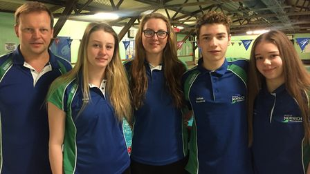 City of Norwich Swimming Club head coach Alex Pinniger with (from left) Megan Pye, Jessica-Jane Appl