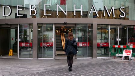 Debenhams says it will cut up to 25% of its store management roles in a reorganisation hoped to make