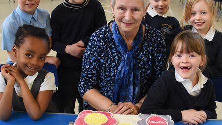 Sue Stevens, retiring from the Nelson Infant School after 38 years as a dinner lady. With her are pu