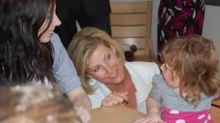 The Countess of Wessex gets to know a young visitor during a visit to Break's Morley House at King's