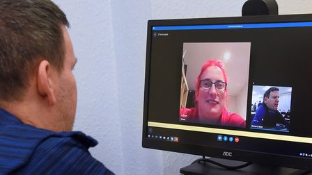 Former student Robyn Steward chats to Anthony Harris, her former support worker, by computer as she
