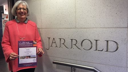 Carole Slaughter, charity coordinator at Jarrold in Norwich, holds a certificate to mark the departm
