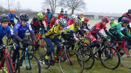 Concentration on getting feet clipped in as the Under 12s start at the Iceni Velo cyclo-cross. Winne
