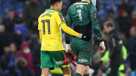 Josh Murphy consoles Angus Gunn following Norwich City's penalty shoot-out defeat to Chelsea. Pictur