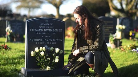 Gemma Clark, a Norfolk Coast Partnership project officer, laying flowers on the grave of Anthony Bow