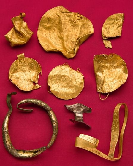 Norfolk Museums Service is loaning this 6th century hoard of Anglo-Saxon gold bracteates and other j