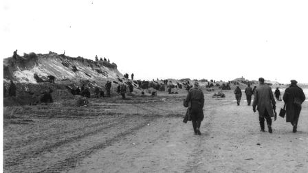 Workers filling sandbags at Sea Palling, one of the pictures taken on his Kodak Brownie camera that