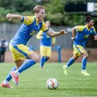 Cameron Norman is ready to stay with Kings Lynn town until the summer, despite interest from league