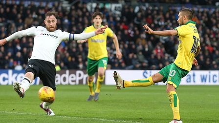 Moritz Leitner of Norwich thinks he's scored his first goal for the club but referee Jeremy Simpson