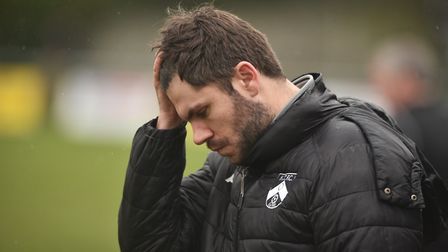 Harleston manager Adam Gusterson cuts a worried figure but he can be pleased with his side's victory