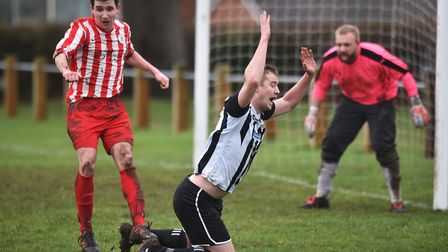 Harleston's Marc Pearce and CEYMS' Ashley Baxter in action. Picture: ANTONY KELLY