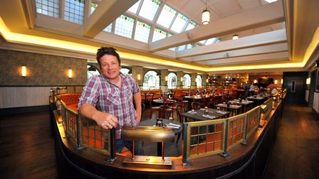 Jamie Oliver at his restaurant in Norwich Royal Arcade, when it opened in 2012. Photo: Bill Smith