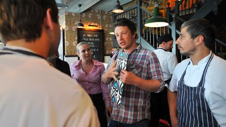 Jamie Oliver talking to staff at the opening of his restaurant in Norwich in 2012. Photo: Bill Smit