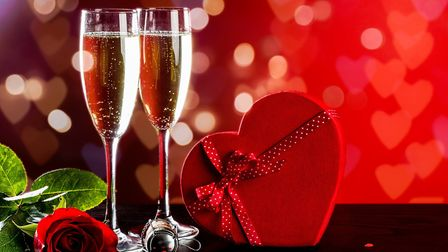 Champagne with roses and chocolates. Picture: Getty Images/iStockphoto