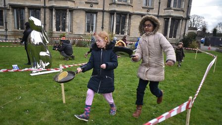 Pancake races at St John the Baptist Cathedral in Norwich.Picture: ANTONY KELLY