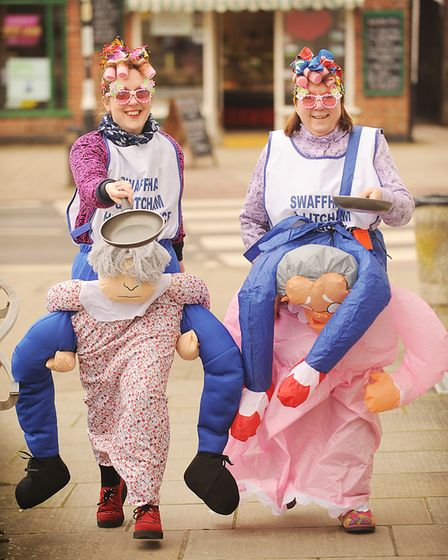 Pancake Day racing at the Assembly Rooms in Swaffham. Pictured are (L) Sarah Leggett and Sue Pert fr