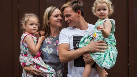 Damion Burbank with wife Emily and daughters Olive and Arabella. Picture: Charlotte Anderson