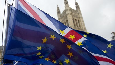 Union and EU flags fly outside Houses of Parliament