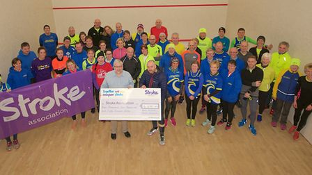 Andy Kett handing the cheque to George Burroughs from the Stroke Association with members of the NNB