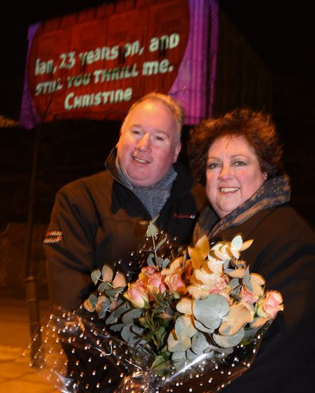 Christine Hendry and her husband Ian Abernethy, with Christine's valentine message to Ian projected