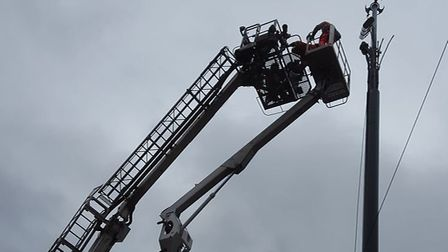 Two communications workers have been rescued after getting stuck on a cherry picker. Picture: Norfol