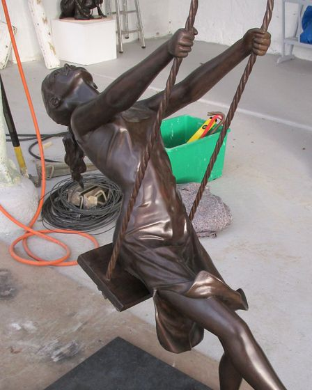 Mitchell House's sculpture Girl on a Swing, which has been flown to Beverley Hills by an American co