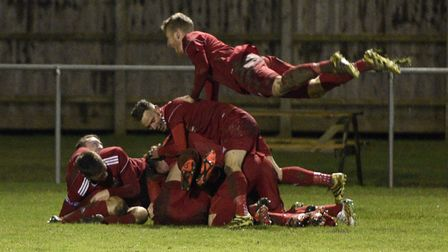 Wisbech Town players celebrate Michael Frew's goal in their victory against Yaxley. Picture: IAN CAR